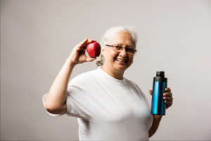 Woman exercising and eating healthy to battle hypertension