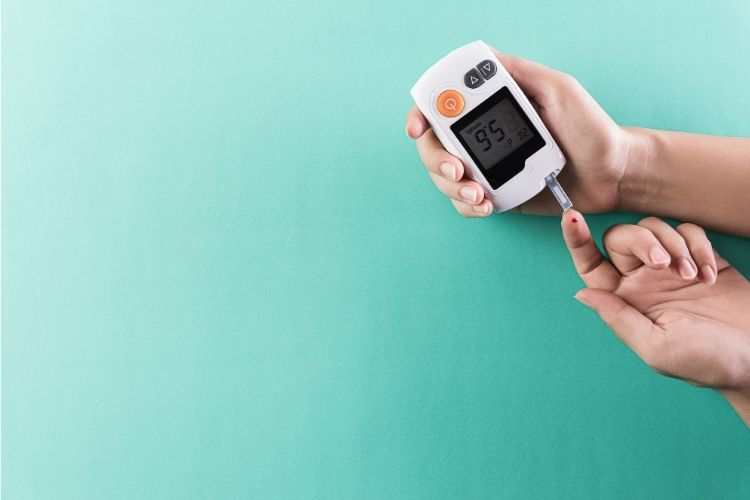 person checking diabetes during COVID-19 with a glucometer