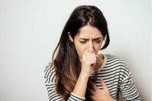 Women coughing from Chronic Obstructive Pulmonary Disease