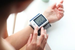 Woman Checking Blood Pressure To Prevent COVID-19 Along With Hypertension